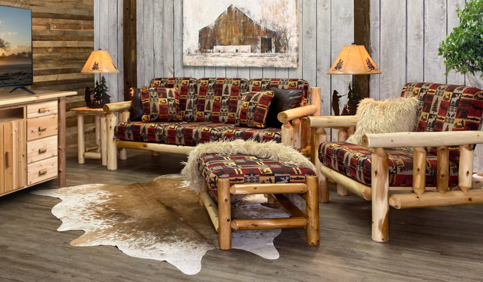 a living room made of log furniture