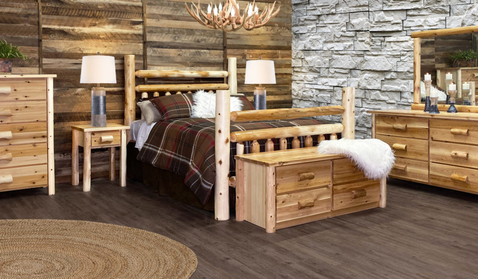 a bedroom made of rustic log furniture